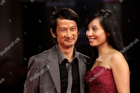Stock Photo of Tran Anh Hung, Tran Nu Yen Khe Director Tran Anh Hung and his wife Tran Nu Yen Khe arrive for the screening of the film Norwegian Wood at the 67th edition of the Venice Film Festival in Venice, Italy