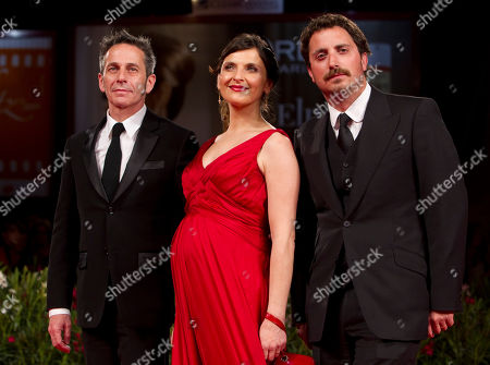 Pablo Larrain, Antonia Zegers, Alfredo Castro From right, Director Pablo Larraín, and actors Antonia Zegers and Alfredo Castro arrive for the screening of the film Post Mortem at the 67th edition of the Venice Film Festival in Venice, Italy, . Zegres is carrying Larrain's child