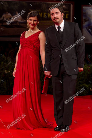 Pablo Larrain, Antonia Zegers Director Pablo Larraín and actress Antonia Zegers arrive for the screening of the film Post Mortem at the 67th edition of the Venice Film Festival in Venice, Italy, . Zegres is carrying Larrain's child