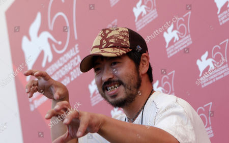 Takashi Shimizu Director Takashi Shimizu poses at the photo call for the film Shock Labyrinth 3D at the 67th edition of the Venice Film Festival in Venice, Italy