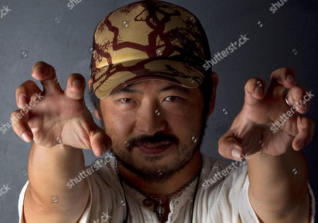 Takashi Shimizu Director Takashi Shimizu mimics the 3-D effects of his movie Senritsu Meikyu 3D (The Shock Labyrinth 3D: Extreme) at the 67th edition of the Venice Film Festival in Venice, Italy
