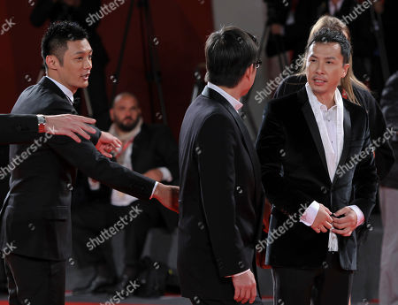 Andrew Lau, Donnie Yen, Shawn Yue Director Andrew Lau, center, and actors Donnie Yen, right, and Shawn Yue arrive for the screening of the movie Jingwu Fengyun Chen Zhen (The legend of the fist: The return of Chen Zhen) at the 67th edition of the Venice Film Festival in Venice, Italy