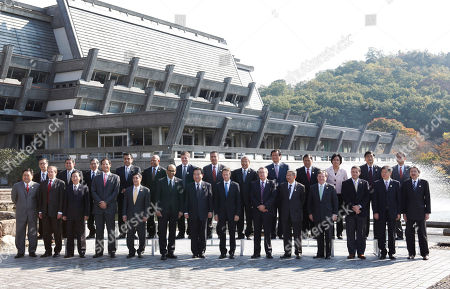 Stock Image of APEC finance ministers and delegates pose during a group photo session in Kyoto, western Japan, . From left in front row are Philippines Finance Secretary Cesar Purisima, Russia's Deputy Finance Minister Dmitry Pankin, Taiwanese Financial Minister Lee Sush-der, Thailand's Finance Minister Korn Chatikavanij, Vietnam's Vice Finance Minister Tran Xuan Ha, Singapore's Finance Minister Tharman Shanmugaratnam, Japanese Finance Minister Yoshihiko Noda, U.S. Treasury Secretary Timothy Geithner, Australian Treasurer Wayne Swan, Brunei's Minister of Finance Pehin Abdul Rahman, Canadian Finance Minister Jim Flaherty, Chilean Head of International Affairs Alfie A. Ulloa, Chinese Vice Minister of Finance Wang Jun, Hong Kong's Financial Secretary John Tsang, From left in back row are, APEC Business Advisory Council (ABAC) Finance and Economics Working Group (FEWG) Chairman Yoshihiko Watanabe, APEC Secretariat Executive Director Muhamad Noor Yacob, ADB President Haruhiko Kuroda, Peruvian Vice Minister of Economy Carlos Casas Tragodara, Papua New Guinea's Ambassador to Japan Dennis Taylor Bebego, New Zealand's Finance Minister Bill English, Mexican Head of International Finance Affairs Unit Ricardo Ernesto, Malaysian Second Finance Minister Ahmad Husni Hanadzlah, South Korea's Finance Minister Yoon Jeung-hyun, Indonesia's Finance Minister Agus Martowardojo, World Bank Managing Director Mulyani Indrawati, IMF Deputy Managing Director Naoyuki Shinohara, EC Economic Committee Chairman Takashi Omori