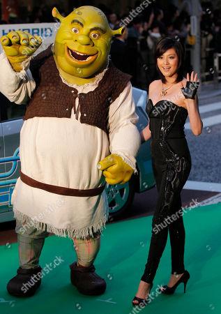 "Norika Fujiwara Japanese actress Norika Fujiwara poses with Shrek-kun on the green carpet upon their arrival for the screening of movie ""Shrek Forever After"" at the opening of the 23rd Tokyo International Film Festival in Tokyo"