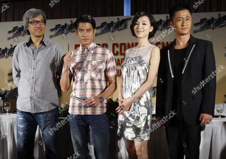 """Benny Chan, Aaron Kwok, Zhang Jingchu, Wu Jing Cast members, from left, Hong Kong director Benny Chan, Hong Kong actor Aaron Kwok, Chinese actress Zhang Jingchu, and Chinese actor Wu Jing pose during a press conference to promote their new movie """"City Under Siege"""" in Kuala Lumpur, Malaysia"""
