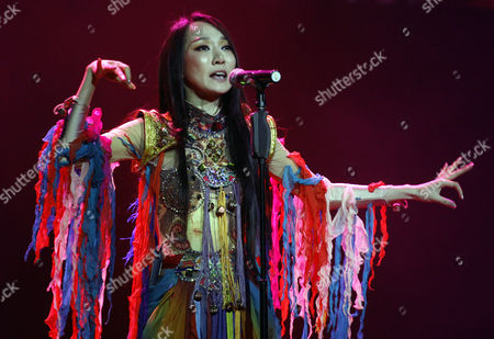 Sa Dingding Chinese folk singer Sa Dingding performs during her music showcase in Kuala Lumpur, Malaysia