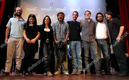 """Carlos Reygadas, Patricia Riggen, Mariana Chenillo, Gerardo Naranjo, Fernando Eimbcke, Amat Escalante, Pablo Cruz, Diego Luna Mexican directors, from left: Carlos Reygadas, Mariana Chenillo, Patricia Riggen, Gerardo Naranjo, Fernando Eimbcke, Amat Escalante, Pablo Cruz and Diego Luna pose for photographs as part of the promotion of their film """"Revolucion"""" or """"Revolution"""", at the Morelia Film Festival in Morelia, Mexico, . """"Revolucion"""" is a movie that includes ten short films, directed by different Mexican movie makers as part of Mexico's Independence bicentennial celebrations. The two directors who are not in the picture are Gael Garcia and Rodrigo Garcia"""