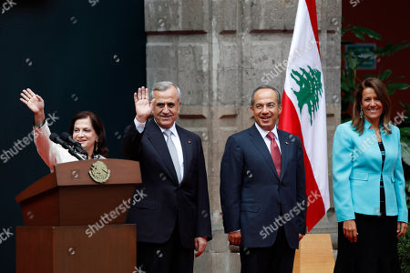 Felipe Calderon, Michel Sleiman Mexico's President Felipe Calderon, center right, his wife Margarita Savala, right, Lebanon's President, General Michel Sleiman, center left, and his wife Wafaa Suleiman, stand prior of a welcoming ceremony at the national palace in Mexico City, . Sleiman is on a one-day official visit to Mexico