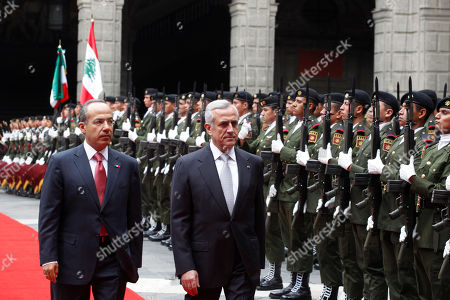 Felipe Calderon, Michel Sleiman Mexico's President Felipe Calderon, left, and Lebanon's President, General Michel Sleiman, review an honor guard during a welcoming ceremony at the national palace in Mexico City, . Sleiman is on a one-day official visit to Mexico