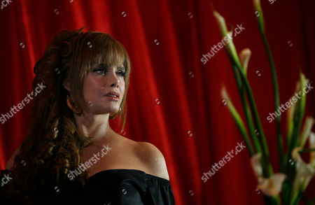 "Actress and singer Lucia Mendez, from Mexico, poses for photos during the presentation of her new album ""Canta un Homenaje a Juan Gabriel"" in Mexico City"