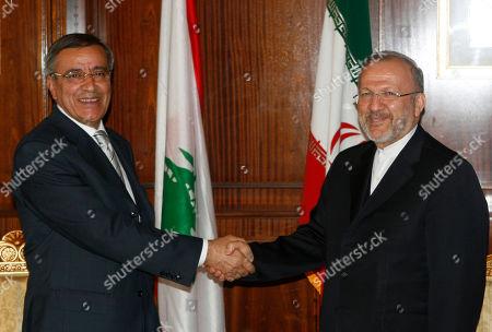 Manouchehr Mottaki Ali Shami Iranian Foreign Minister Manouchehr Mottaki, right, shakes hands with his Lebanese counterpart Ali Shami, during their meeting in Tehran, Iran