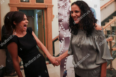 "Stock Image of Yasmine Elmasri, Ruba Blal Palestinian actresses Yasmine Elmasri, left, and Ruba Blal share a laugh before the screening of the movie ""Miral"" at the Al-Kasaba International Film Festival, in the West Bank city of Ramallah. The Indian actress Freida Pinto, who starred in ""Slumdog Millionaire"" has moved from the slums of Mumbai to the squalid refugee camps of the West Bank in the new film ""Miral"": the story of a defiant Palestinian girl who wants to fight against Israel in a coming of age story with a Mideast twists. Due for U.S. release in December, it's likely to give Western audiences - some perhaps more used to movies depicting Arabs as violent Islamic militants - a compassionate view of the Palestinians"