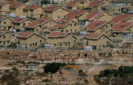 Israeli earth-moving equipment works in the Jewish settlement of Kiryat Netafim, near the West Bank village of Salfit, . Senior Palestinian official Yasser Abed Rabbo said Monday that President Mahmoud Abbas remains ready to walk out on Mideast peace talks if Israel resumes construction in its West Bank settlements now that building restrictions have expired