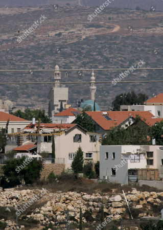 General view of the Jewish settlement of Kiryat Netafim, back-dropped by the West Bank village of Salfit, . Senior Palestinian official Yasser Abed Rabbo said Monday that President Mahmoud Abbas remains ready to walk out on Mideast peace talks if Israel resumes construction in its West Bank settlements now that building restrictions have expired