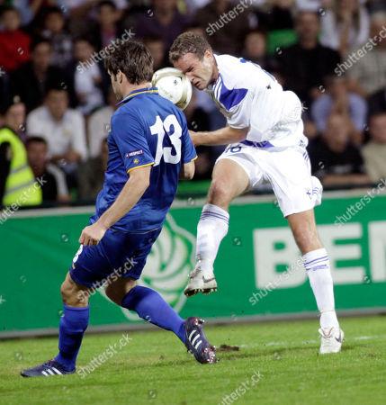 Finland's Jonatan Johansson, right is challenged by Moldova's Semion Bulgaru during their Euro 2012 Group E qualifying soccer match in Chisinau, Moldova