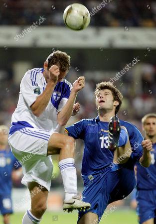 Finland's Jonatan Johansson is challenged by Moldova's Semion Bulgaru during their Euro 2012 Group E qualifying soccer match in Chisinau, Moldova