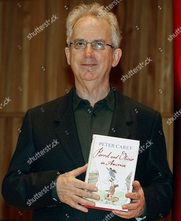 """Peter Carey Author Peter Carey poses with his book """"Parrot and Olivier in America"""", in London"""