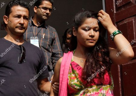 """Stock Photo of Nihita Biswas Nihita Biswas, right, reportedly married to 65-year-old convicted French serial killer Charles Sobhraj, is accompanied by a relative as they come out from the Supreme Court in Katmandu, Nepal, . Nepal's Supreme Court upheld the conviction of Sobhraj nicknamed """"The Serpent"""" who was convicted of slaying an American tourist in Katmandu more than three decades ago. Sobhraj would serve his life sentence in a Nepali jail"""