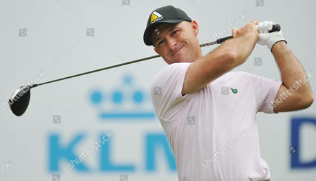Robert Coles of England hits his tee shot during the final round of the KLM Open golf tournament at the Hilversum Golf Club in Hilversum, western Netherlands
