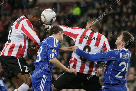 PSV players Marcelo, left, and Orlando Engelaar, right, try and head the ball as Debrecen Peter Mate, second left, and Mirsad Mijadinoski, right, try and intercept during the Europa League group I soccer match PSV versus Debrecen at Philips stadium in Eindhoven, Netherlands