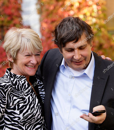 Andre Geim, right, is seen on the phone alongside President and Vice Chancellor of Manchester University Nancy Rothwell after being awarded the Nobel Prize for Physics along with colleague Konstantin Novoselov, Manchester, England, . Two Russian-born scientists shared the Nobel Prize in physics on Tuesday for groundbreaking experiments with the strongest and thinnest material known to mankind _ a potential building block for faster computers and lighter airplanes and satellites