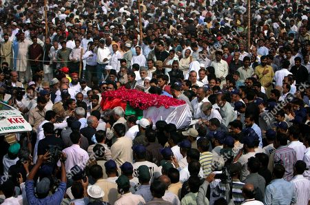 Mourners carry the coffin of Pakistani slain politician Imran Farooq during his funeral prayer at a park in Karachi, Pakistan on . Thousands of mourners attended the funeral Saturday of Farooq who was stabbed in London in September in a slaying that set off rioting in his hometown of Karachi