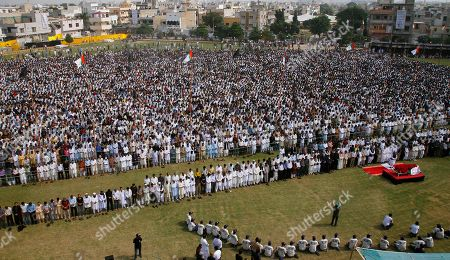 Thousands of mourners offer funeral prayers for Pakistani slain politician Imran Farooq at a park in Karachi, Pakistan on . Thousands of mourners attended the funeral Saturday of a Pakistani politician who was stabbed in London in September in a slaying that set off rioting in his hometown of Karachi