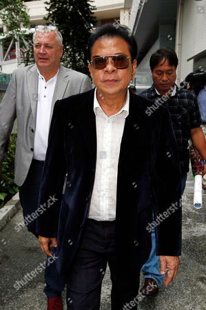 "Luis ""Chavit"" Singson Ronald Singson's father, Governor of Ilocos Sur Luis ""Chavit"" Singson leaves a court in Hong Kong . A Hong Kong court Thursday granted bail to a Philippine legislator and son of a prominent politician after he spent more than a month in police custody on drug charges. Hong Kong airport authorities arrested Philippine Rep. Ronald Singson, 41, on July 11 on suspicion of trafficking in cocaine after a flight from Manila"