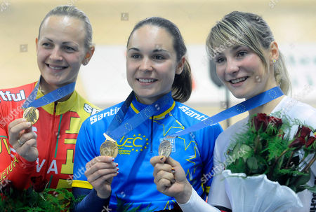 Simona Krupeckaite,Sandie Clair, Kristina Vogel From left, Lithuania's Simona Krupeckaite, third place, France's Sandie Clair, the winner, and Germany's Kristina Vogel, second place, present their medals after the awarding ceremony for the Women's Sprint during the European Track Cycling Championships in Pruszkow, near Warsaw, Poland