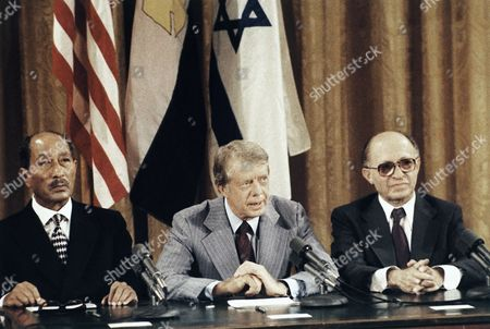 Jimmy Carter, Menachem Begin, Anwar Sadat President Jimmy Carter is flanked by Israeli Prime Minister Menachem Begin and Egypt's President Anwar Sadat as they faced newsmen at the conclusion of their discussions toward Middle East Peace moves at Carter's Camp David retreat in Maryland in September 1978