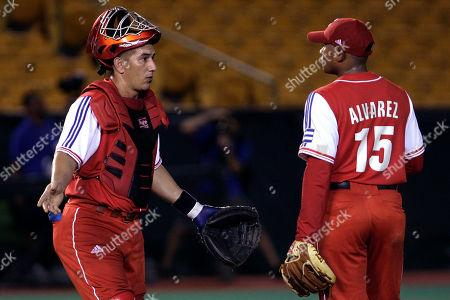Ariel Pestano, Freddy Alvarez Cuba's catcher Ariel Pestano, left, gestures while talking to pitcher Freddy Alvarez during a Baseball World Cup qualifier game against Nicaragua in Carolina, Puerto Rico