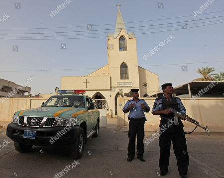 Iraqi policemen stand guard outside Evangelical Protestant church in Baghdad, Iraq, . There are fears of a backlash against Christians in predominantly Muslim countries. Canon Andrew White, the chaplain of an Anglican church in Baghdad, said the Iraqi military had warned him that his church had been threatened. Security was beefed up around the Church of Virgin Mary in central Baghdad on Thursday, with military vehicles blocking the entrance to the church and more soldiers were deployed to guard it