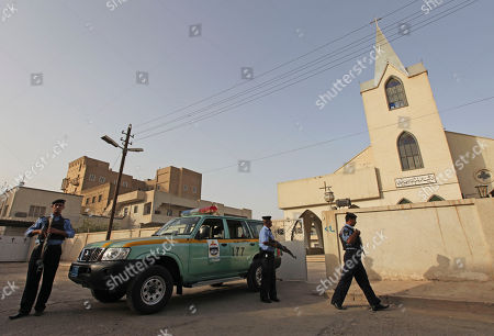 Iraqi policemen stand guard outside Evangelical Protestant churchin Baghdad, Iraq, . There are fears of a backlash against Christians in predominantly Muslim countries. Canon Andrew White, the chaplain of an Anglican church in Baghdad, said the Iraqi military had warned him that his church had been threatened. Security was beefed up around the Church of Virgin Mary in central Baghdad on Thursday, with military vehicles blocking the entrance to the church and more soldiers were deployed to guard it