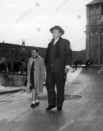 Orson Welles, Rebecca Welles Rebecca Welles goes sightseeing with her famous father, actor-author-director Orson Welles, in Pisa, Italy on October 12. Rebecca, 12, game to Europe with her mother, screen star Rita Hayworth and was accompanied to Pisa by an English governess for the visit with her father