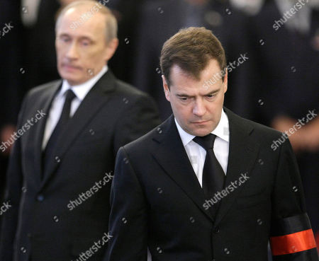 Dmitry Medvedev,Vladimir Putin Russian President Dmitry Medvedev, right, and Prime Minister Vladimir Putin, left, are seen as pay last respect to former Russian Prime Minister Viktor Chernomyrdin during a memorial ceremony in Moscow, Russia, . Viktor Chernomyrdin, who served as Russia's prime minister in the turbulent 1990s as the country was throwing off communism and developing as a market economy, died Wednesday. Chernomyrdin will be buried in Novodevichy Cemetery in Moscow this Friday
