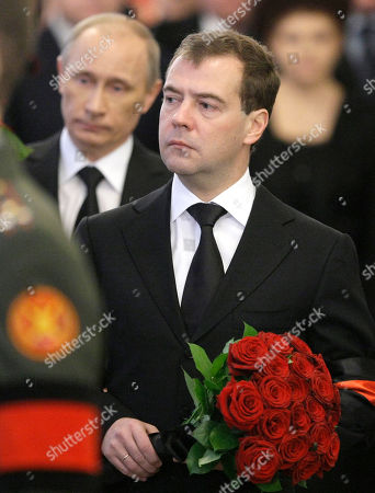 Dmitry Medvedev,Vladimir Putin Russian President Dmitry Medvedev, right, and Prime Minister Vladimir Putin, left, pay last respect to former Russian Prime Minister Viktor Chernomyrdin during a memorial ceremony in Moscow, Russia, . Viktor Chernomyrdin, who served as Russia's prime minister in the turbulent 1990s as the country was throwing off communism and developing as a market economy, died Wednesday. Chernomyrdin will be buried in Novodevichy Cemetery in Moscow this Friday