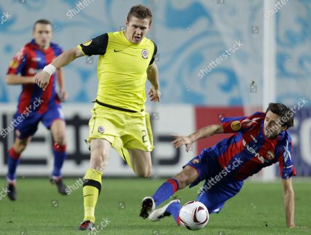 Sparta Prague's Tomas Repka, center, fights for the ball with CSKA Moscow's Deividas Semberas during the Europa League group F soccer match in Moscow