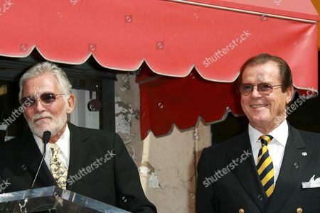 Stock Image of Sir Roger Moore and David Hedison