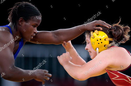 Jenna Rose Burkert, Christiana Victor Jenna Rose Burkert of the United States, right, wrestles against Christiana Victor of Nigeria during the women's 60-kilogram freestyle wrestling at the Youth Olympics on in Singapore