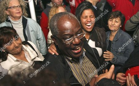 """Stock Photo of Peter Bossman Peter Bossman, center, a Ghana-born physician celebrates his electoral victory in Piran, Slovenia, late . Slovenia has elected its first black mayor, an immigrant from Africa known as the """"Obama of Piran,"""" the town where he lives"""