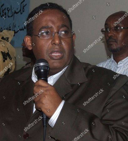 Prime Minister Omar Abdirashid Ali Sharmarke delivers a speech to the MPs during a session at Parliament building in Mogadishu, Somalia, . Sharmarke survived a no-confidence vote in parliament Thursday Aug. 5, 2010 after members of the parliaments who presented the motion to the speaker were absent from Thursday's meeting