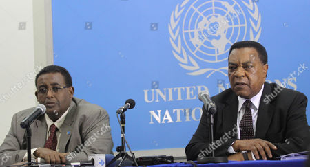 Somali Prime Minister Omar Abdirashid Ali Sharmarke, left, and U.N. envoy to Somalia Augustine Mahiga, right, speak to journalists about developments in Somalia in Nairobi, Kenya, . Mahiga said that in coming months international staff from the organization may work in the battle-scarred Somali capital of Mogadishu, for the first time in many years