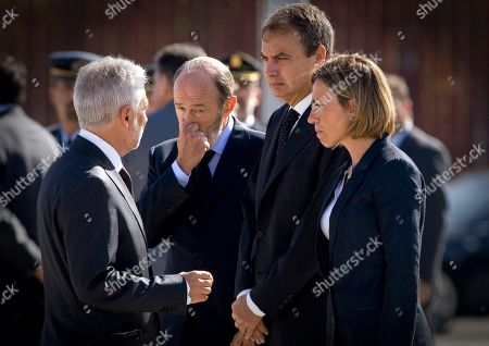 Jose Luis Rodriguez Zapatero, Carme Chacon, Alfredo Perez Rubalcaba Spain's Prime Minister Jose Luis Rodriguez Zapatero, centre right, Spain's Defence Minister Carme Chacon, right, and Spain's Interior Minister Alfredo Perez Rubalcaba, 2nd left, during the funeral of of a Spanish Civil Guards, Jose Maria Galera Cordoba, Leoncio Bravo Picallo and their translator Ataola Taefik Alili at the Torrejon military airbase just outside of Madrid on . Flag-draped coffins holding the remains of three Spaniards killed in Afghanistan in what the government calls a terrorist attack have been brought back to Spain. A band played Chopin's Funeral March Thursday as Civil Guard pallbearers carried caskets with the bodies of two police officers and an Iranian-born interpreter who were shot by an Afghan man Wednesday at a NATO base during a training class for local police recruits