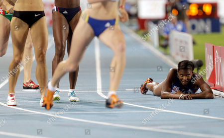 Stock Picture of France's Muriel Hurtis-Houairi looks up as she lies on the track during the Women's 4x400m Relay final at the European Athletics Championships, in Barcelona, Spain