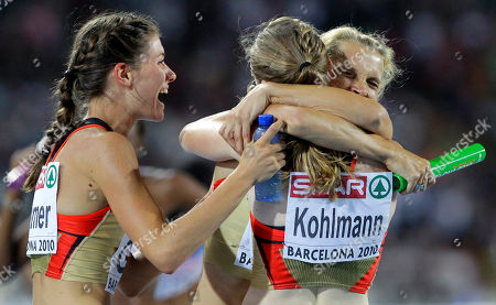 Stock Image of Germany's Esther Cremer, left, Germany's Fabienne Kohlmann, front right, and Claudia Hoffmann celebrate after winning the silver medal in the Women's 4x400m Relay final during the European Athletics Championships, in Barcelona, Spain