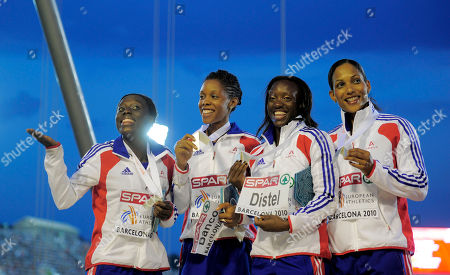 From left, France's Veronique Mang, Lina Jacques-Sebastien, Myriam Soumare and Christine Arron pose with their Women's 4x100m Relay silver medals during the European Athletics Championships, in Barcelona, Spain