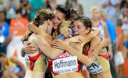 Stock Photo of Germany's Fabienne Kohlmann, left, Janin Lindenberg, front center, Claudia Hoffmann and Esther Cremer, right, celebrate their silver medal in the Women's 4x400m Relay final during the European Athletics Championships, in Barcelona, Spain