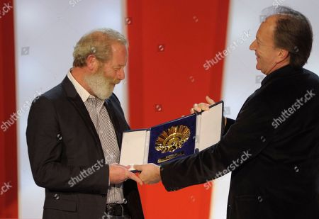 Peter Mullan British director Peter Mullan, left, receives the best movie Golden Shell award for his film 'Neds' from the judging panel director Goran Paskaljevic, at the 58th San Sebastian Film Festival in San Sebastian northern Spain, . The movie, an insightful exploration of the violent upheavals of adolescence within the harsh environment of 1970s Glasgow in Scotland, tells of the struggle of a young John McGill to make his mark on life