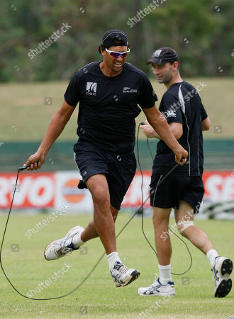 Daryl Tuffey, Andy Mckay New Zealand's Daryl Tuffey, left, jumps rope while running as teammate Andy Mckay looks on during a practice session in Dambulla, Sri Lanka, . India, Sri Lanka and New Zealand are currently playing the tri nation cricket series