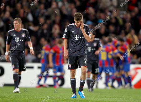 Sebastian Schweinsteiger, Thomas Mueller Munich's Sebastian Schweinsteiger, left, and Thomas Mueller react while Basel's teammates celebrate in background after scoring during the Champions League Group E soccer match between FC Basel and FC Bayern Munich in Basel, Switzerland, on
